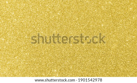 Gold glitter texture background sparkling shiny wrapping paper for Christmas holiday seasonal wallpaper  decoration, greeting and wedding invitation card design element Royalty-Free Stock Photo #1901542978