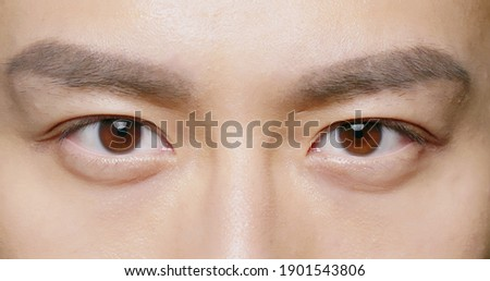 slow motion of male eye close up from asian young man Royalty-Free Stock Photo #1901543806