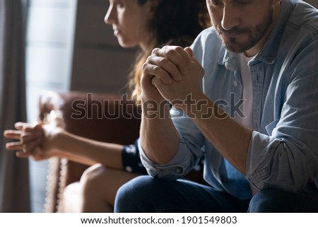 Crop close up of unhappy young couple sit separate have problems in relationship think of breakup or divorce. Upset man and woman family lovers avoid talking suffer from cheating in relation troubles. Royalty-Free Stock Photo #1901549803