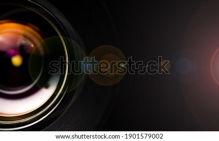 Camera lens with lense reflections.Camera lens detail, front glass of wide angle photography DSLR camera lens, macro shot, selective focus.