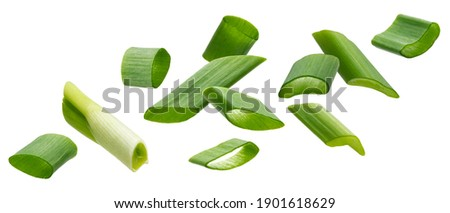 Falling green onion slices, fresh cut chives isolated on white background with clipping path Royalty-Free Stock Photo #1901618629