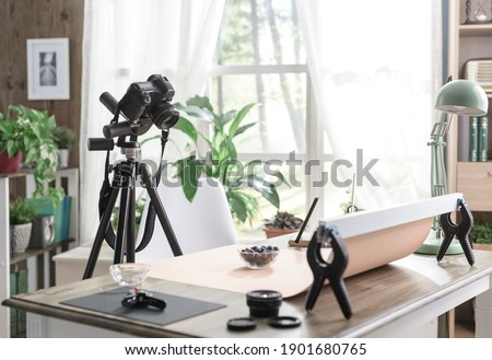 Food photography set at home with ready camera on a tripod, room interior in the background