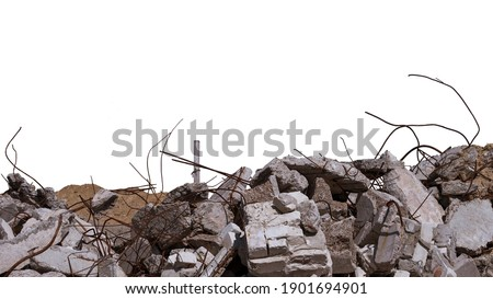 Concrete remains of a ruined building with exposed rebar, isolated on a white background. Background. Royalty-Free Stock Photo #1901694901