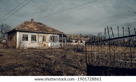 Rusty, residential gates in front of an abandoned house. old house in Moldova. traditional house in the village. Moldavian, people's house Royalty-Free Stock Photo #1901728861
