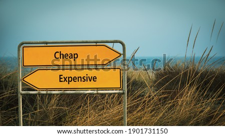 Street Sign the Direction Way to Cheap versus Expensive