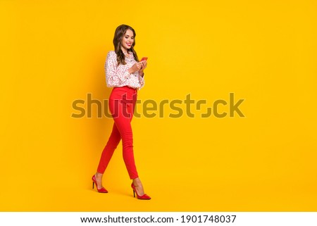 Full size profile photo of walking lady write blog post wear positive comment isolated on yellow color background