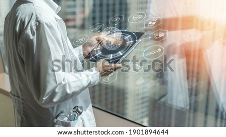 Medical tech research, innovative iot global healthcare ai technology with telehealth, telemedicine service concept with doctor analyzing online on EHR, EMR big data  patient health record in hospital Royalty-Free Stock Photo #1901894644