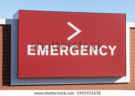 Red Emergency Entrance Sign for a Local Hospital Royalty-Free Stock Photo #1901921638