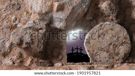 Empty Tomb, open Door And Three Crosses In The Distance on sunset sky background with copy space for inscription.  Christian Easter concept. Royalty-Free Stock Photo #1901957821