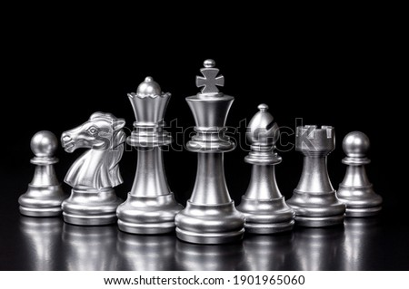 Silver chess pieces six different types used on chessboard to play the game of chess. king, queen, bishop, knight, rook, pawn isolated on black background