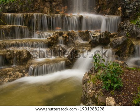 Small waterfall in the Di Negro villa park in Genoa           Royalty-Free Stock Photo #1901988298