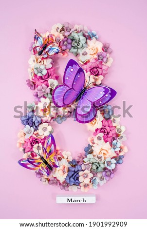 International Women's Day. Banner, flyer, beautiful postcard for March 8. Flowers and butterflies in the shape of the number eight on a pink background. Royalty-Free Stock Photo #1901992909