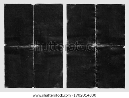 Old Black Empty Ripped Folded Torn Cardboard Paper Poster. Grunge Scratched Old Shabby Surface. Distressed Overlay Texture for Collage.  Royalty-Free Stock Photo #1902014830