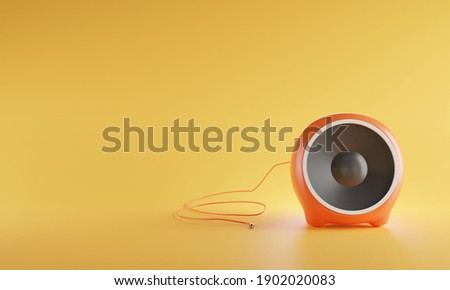3D portable orange color sphere audio speaker isolated on yellow background with clipping path. Minimalism concept. 3d rendering