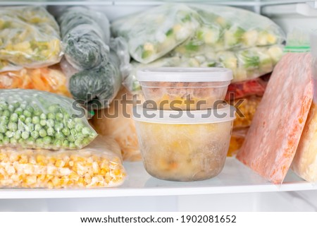 Frozen food in the freezer. Frozen vegetables, soup, ready meals in the freezer Royalty-Free Stock Photo #1902081652