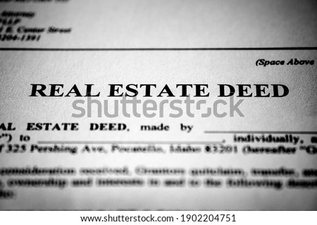 Real estate deed to transfer ownership of land or property Royalty-Free Stock Photo #1902204751