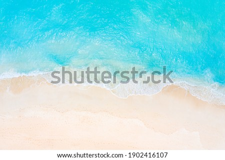 Relaxing aerial beach scene, summer vacation holiday template banner. Waves surf with amazing blue ocean lagoon, sea shore, coastline. Perfect aerial drone top view. Peaceful bright beach, seaside Royalty-Free Stock Photo #1902416107