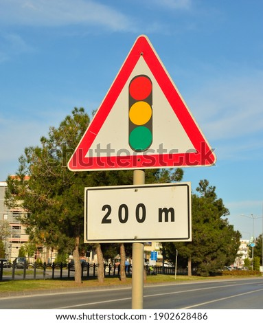 Traffic sign. Traffic lghts after 200 meters.