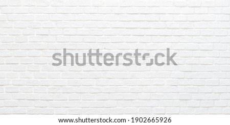 White brick wall texture background for stone tile block painted in grey light color wallpaper modern interior and exterior and backdrop design Royalty-Free Stock Photo #1902665926