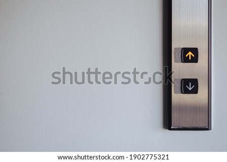 Up and down button in front of the Elevator for direction, up red light with copy space Royalty-Free Stock Photo #1902775321