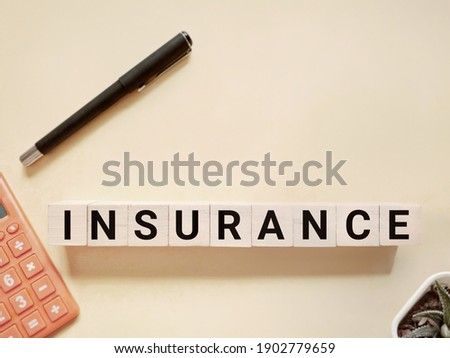 Healthcare and Financial Concept - INSURANCE text on wooden blocks background. Stock photo.