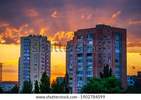 Modern buildings of residential buildings in the city against the backdrop of the setting sun