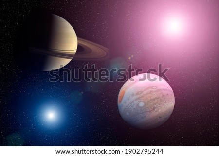 Great Conjunction: Jupiter and Saturn. Jupiter and Saturn meet in the space solar system. Elements of this image furnished by NASA.