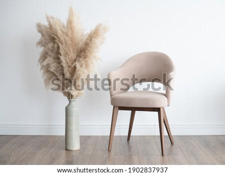Stylish Scandinavian modern white cozy eco interior in minimalist style.Modern home decor. Open space. Royalty-Free Stock Photo #1902837937
