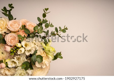 A bouquet of flowers in a vase on a table. Valentine greeting card background. Greeting card for birthday. Selective focus. High quality photo