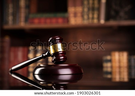 Lawyers office. Judges gavel on glossy table. Royalty-Free Stock Photo #1903026301