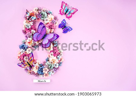 International Women's Day. Banner, flyer, beautiful postcard for March 8. Flowers and butterflies in the shape of the number eight on a pink background. Royalty-Free Stock Photo #1903065973