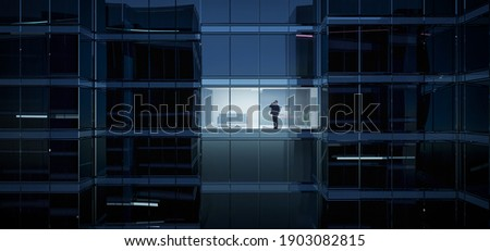 Businessman using mobile phone to talk business in office. View from the outside 3D rendering commercial skyscraper. Royalty-Free Stock Photo #1903082815