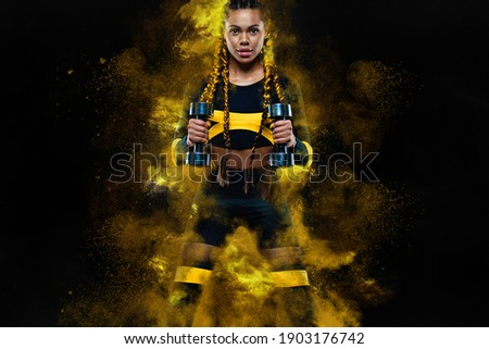 African american woman athlete bodybuilder. Muscular young fitness sports woman workout with dumbbells in fitness gym. Royalty-Free Stock Photo #1903176742