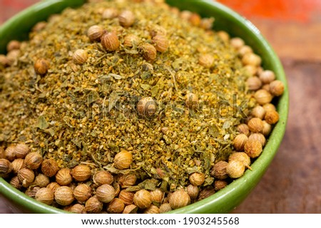 Local food of Canarian islands, dried herbal mix with coriander seeds for mojo cilantro condiment sause close up Royalty-Free Stock Photo #1903245568