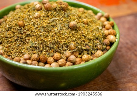 Local food of Canarian islands, dried herbal mix with coriander seeds for mojo cilantro condiment sause close up Royalty-Free Stock Photo #1903245586