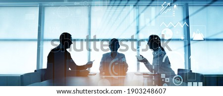 Double exposure of virtual screen and colleagues at business meeting in office Royalty-Free Stock Photo #1903248607
