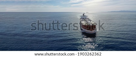 Aerial drone ultra wide photo of latest technology in safety standards crude oil tanker cruising Saronic Gulf deep blue sea, Greece Royalty-Free Stock Photo #1903262362
