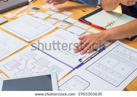 Web designer, creative planning, application development, user experience concept outline. Royalty-Free Stock Photo #1903303630