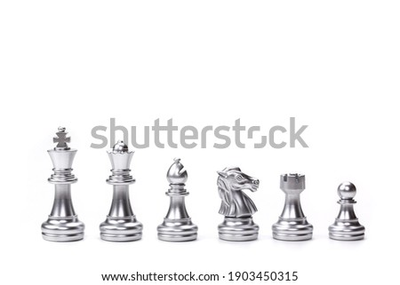 Silver chess pieces six different types used on chessboard to play the game of chess. left to right: king, queen, bishop, knight, rook, pawn isolated on white background