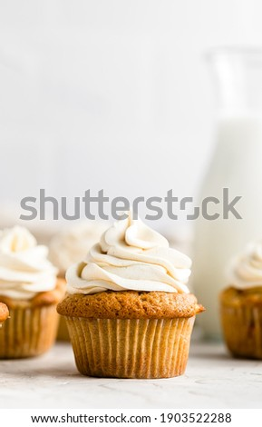 Apple Cupcakes with Maple Buttercream Frosting: soft, fluffy, moist cupcakes filled with tender apples and cozy spices and topped with a creamy maple buttercream frosting. Royalty-Free Stock Photo #1903522288