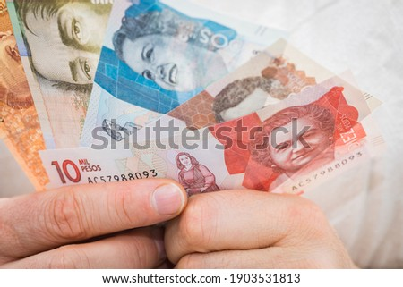 Colombian pesos. Money held in a man's hand Royalty-Free Stock Photo #1903531813