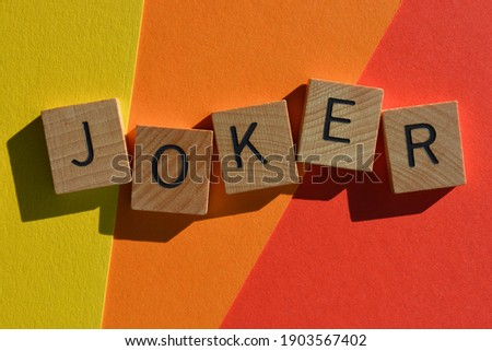 Joker, word in wooden alphabet letters isolated on colourful background