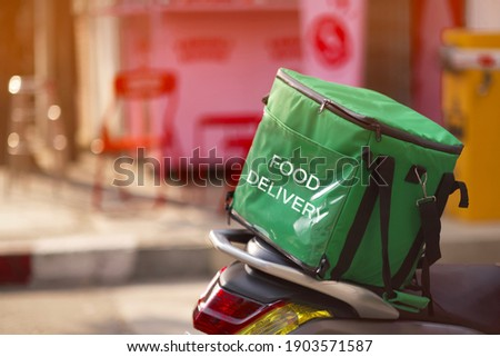 Food delivery service, green food box on motorcycles food delivery