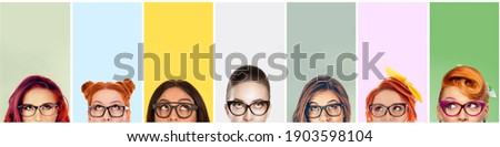 closeup portrait headshot cropped faces above lips of funny women in glasses looking up isolated on colorful studio wall background with copy space above head. Human face expressions, emotions