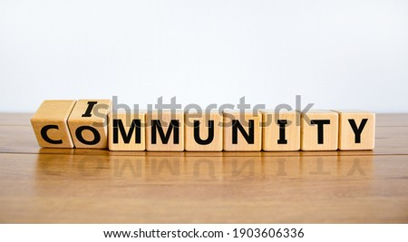 Community immunity symbol. Turned cubes and changed the word 'community' to 'immunity'. Beautiful white background, copy space. Business, medical and community immunity covid-19 concept. Royalty-Free Stock Photo #1903606336