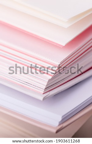 Close up pink and white pages of a open book, vertical Royalty-Free Stock Photo #1903611268