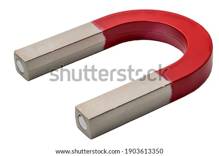 Magnetism, science tools and magnetic attraction concept with close up photograph on red and silver magnet in shape of horseshoe isolated on white background with clipping path cutout Royalty-Free Stock Photo #1903613350