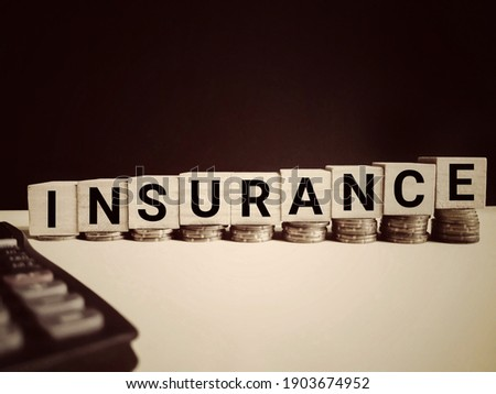 Financial Concept - INSURANCE text in vintage background. Stock photo.