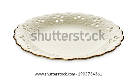 Empty plate with golden pattern edge, White round plate features a beautiful gold rim with floral pattern,   isolated on white background with clipping path, Side view                             Royalty-Free Stock Photo #1903734361