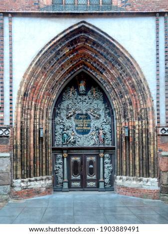 West portal of St. Nicholas Church, Brick Gothic building from 1276, Stralsund, Mecklenburg-Western Pomerania, Germany Royalty-Free Stock Photo #1903889491